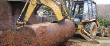Excavation machine performing residential oil tank removal