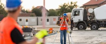 Surveyors on construction site demolition preparation mikula contracting home projects