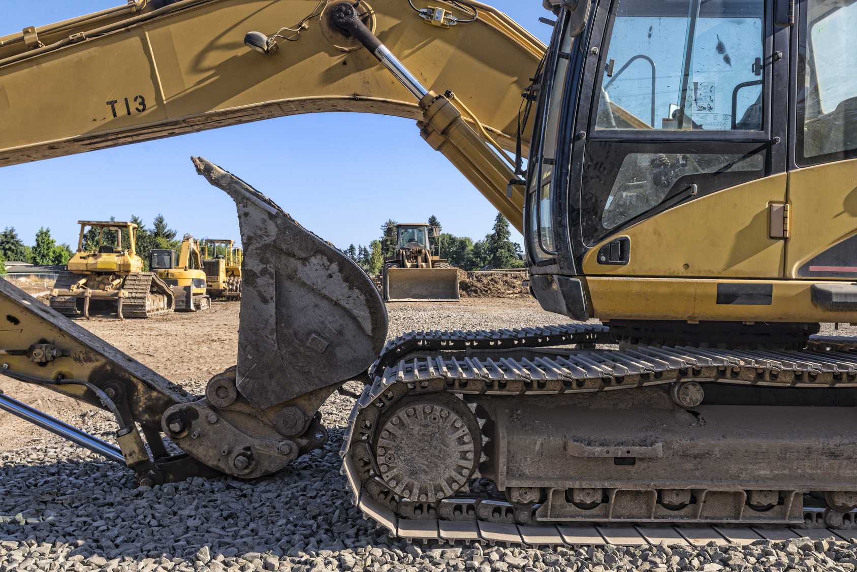 Heavy equipment is seen behind a backhoe. excavation services new jersey
