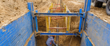 trench shoring job being done by excavation firm